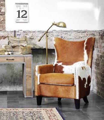 cowhide arm chair.jpg slider